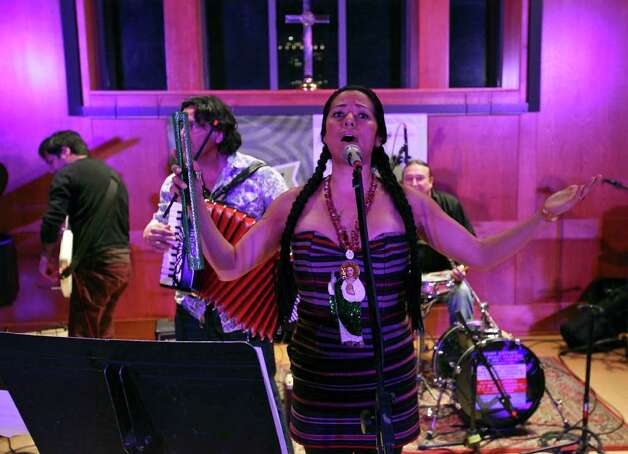 "Lila Downs performs at a Woody Guthrie tribute at St. David's Episcopal Church during South by Southwest in Austin.  ""His spirit and his path just gave me strength,"" she said. Photo: Edward A. Ornelas, San Antonio Express-News / © SAN ANTONIO EXPRESS-NEWS (NFS)"
