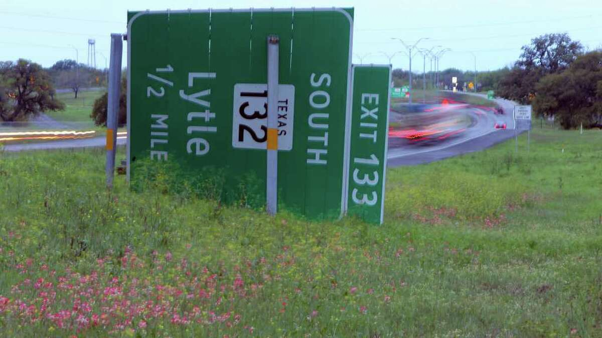 A highway sign is on its side on Interstate 35 after storms swepth through south of San Antonio Monday night. (Tuesday March 20, 2012) John Davenport/San Antonio Express-News
