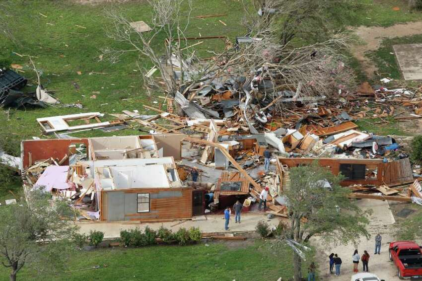 An aerial shows tornado damage in the Devine area on Tuesday, March 20, 2012. A tornado touched down Monday night in Devine damaging 15 homes, according to local offials. andthe in Devine area.