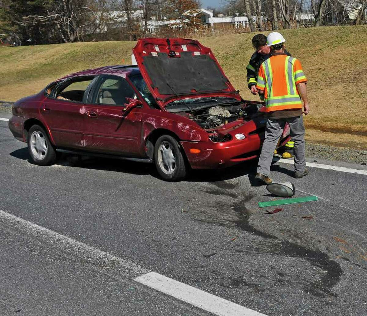 An accident on the northbound lane of the Thruway between exits 23 and 24 tied up traffic on Tuesday morning March 20, 2012 in Albany, N.Y. The car appears to have damaged jersey barriers on the road, where a construction project is underway. (Philip Kamrass / Times Union )