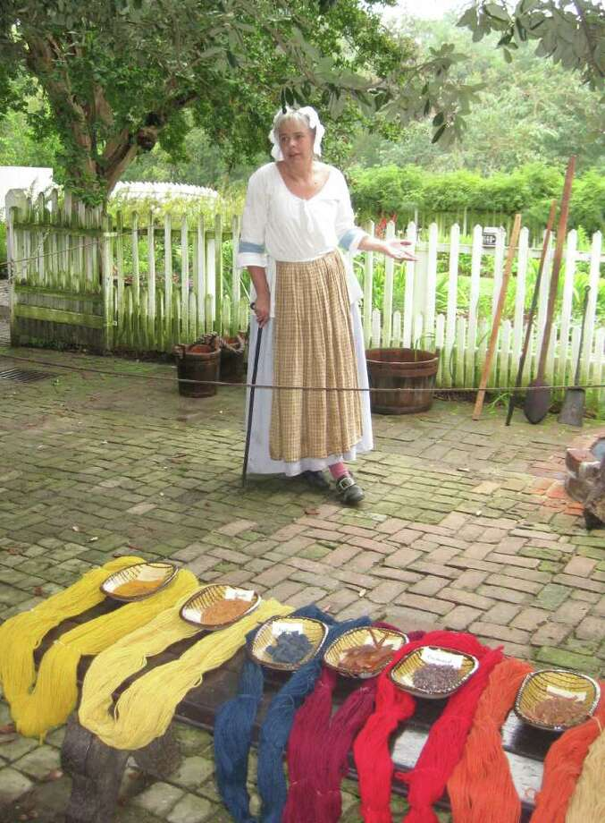 A Colonial Williamsburg dye mistress shows how 18th-century craftspeople colored fabric. Photo: KATHLEEN SCOTT / For The Express-News