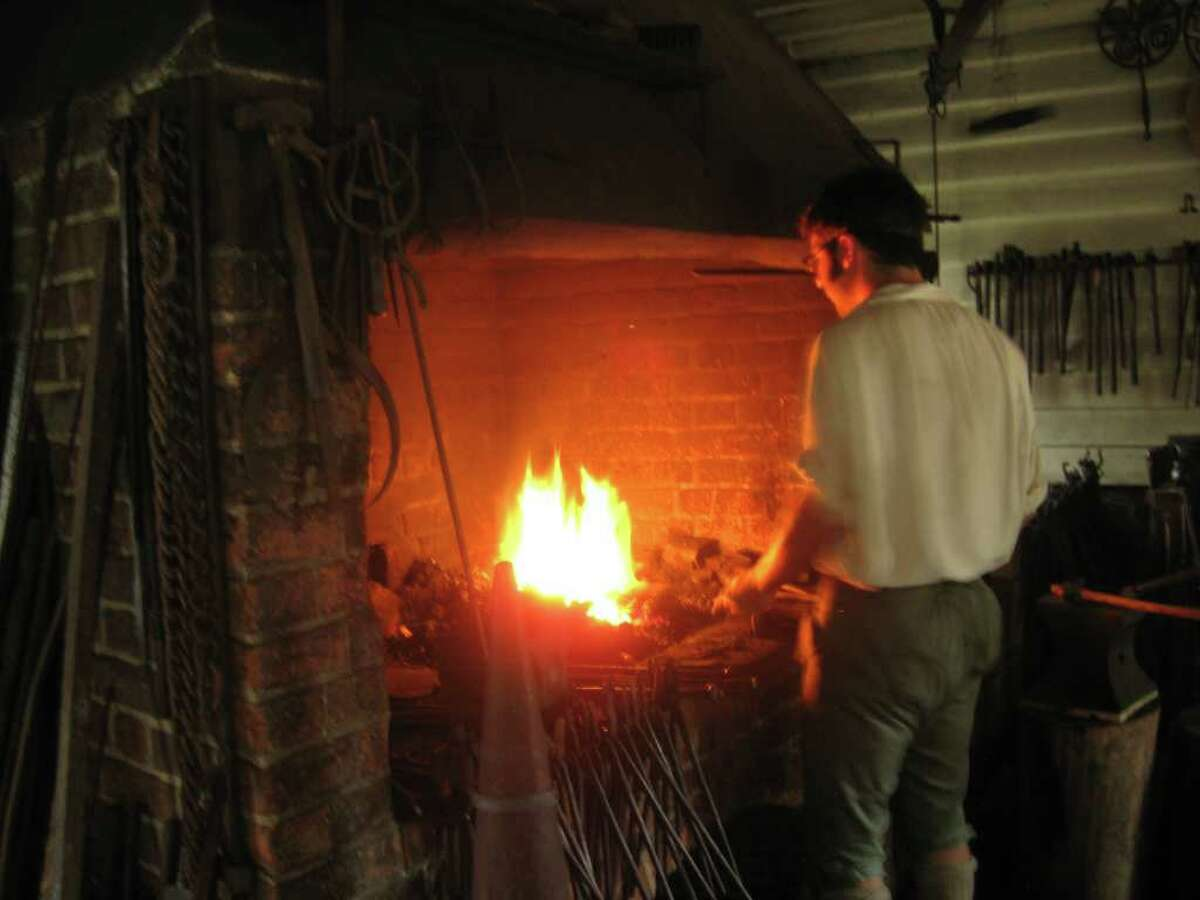 A blacksmith in Colonial Williamsburg.