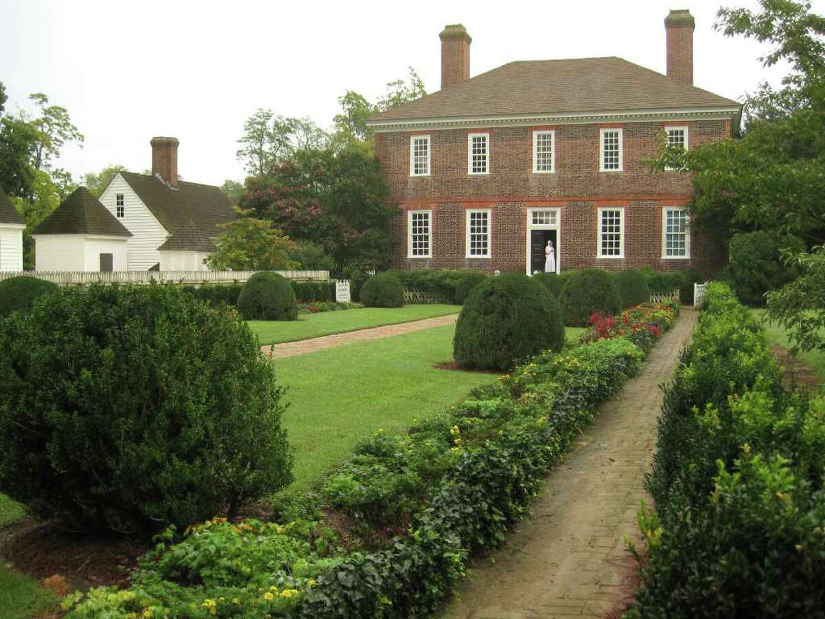 Inside the 1750's George Wythe home, visitors hear stories of Wythe, the first Virginia signer of the Declaration of Independence, and of his pupil Thomas Jefferson, who studied law there. .
