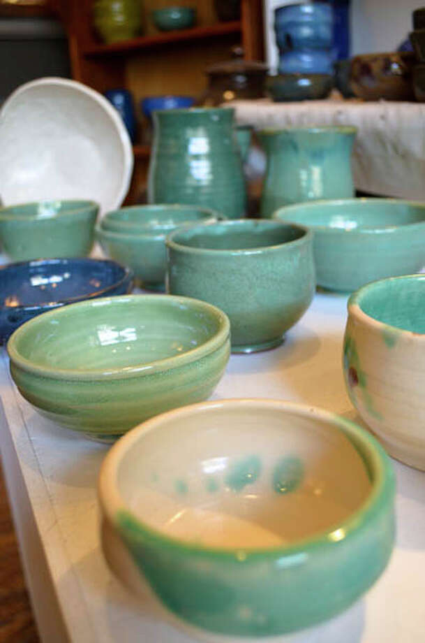 """Bianca Dupuis, potter and owner of The Broken Mold in Troy, makes bowls, mugs, plates, and other """"functional items."""" Read the story here. Photo: Photos By Tyler Murphy/Life@Home"""