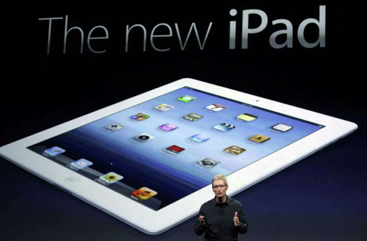 Apple CEO Tim Cook introduces the new iPad during an event in San Francisco, Wednesday, March 7, 2012. The new iPad features a sharper screen and a faster processor. Apple says the new display will be even sharper than the high-definition television set in the living room. (AP Photo/Paul Sakuma)