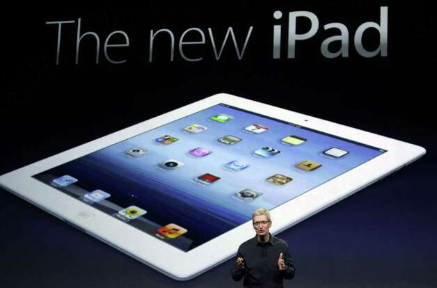 Apple CEO Tim Cook introduces the new iPad during an event in San Francisco, Wednesday, March 7, 2012.  The new iPad features a sharper screen and a faster processor.  Apple says the new display will be even sharper than the high-definition television set in the living room. (AP Photo/Paul Sakuma) Photo: Paul Sakuma, Associated Press / Associated Press