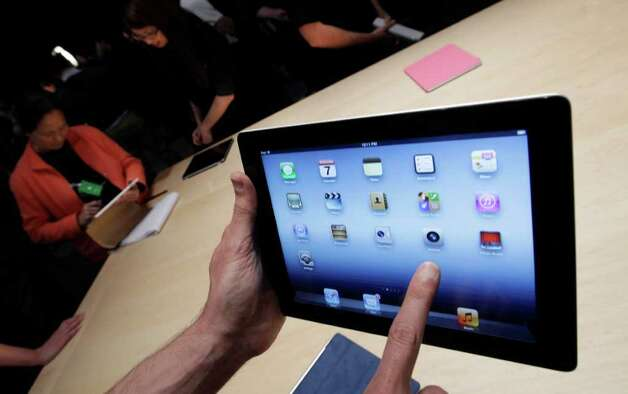 A new Apple iPad is on display during an Apple event in San Francisco, Wednesday, March 7, 2012. The new iPad features a sharper screen and a faster processor.  Apple says the new display will be even sharper than the high-definition television set in the living room. (AP Photo/Paul Sakuma) Photo: Paul Sakuma, ASSOCIATED PRESS / AP2012