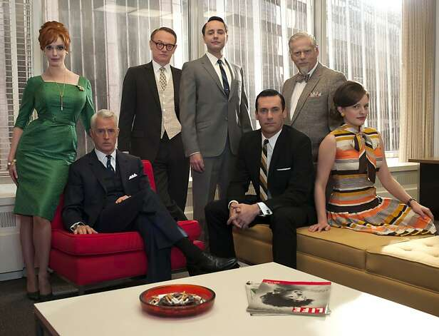 "In this undated image released by AMC, the cast of ""Mad Men,"" from left, Christina Hendricks, John Slattery, Jared Harris, Vincent Kartheiser, Jon Hamm, Robert Morse and Elisabeth Moss are shown. The fifth season the stylized AMC drama about the men and women who work in Madison Avenue advertising in the 1960s, premieres March 25, 2012 at 9 p.m. EST on AMC.  (AP Photo/AMC, Frank Ockenfels) Photo: Frank Ockenfels, Associated Press"