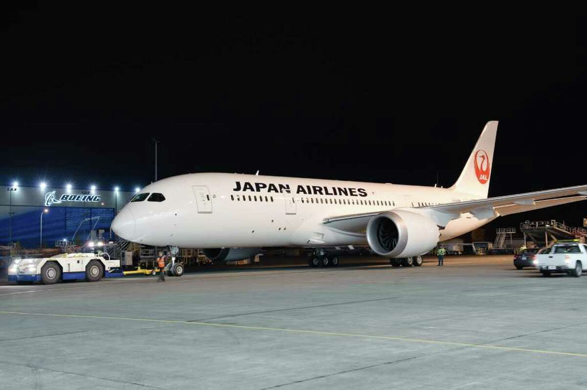 Boeing rolls the first 787 Dreamliner set to enter service with Japan Airlines out of the paint hangar on Dec. 13, 2011.