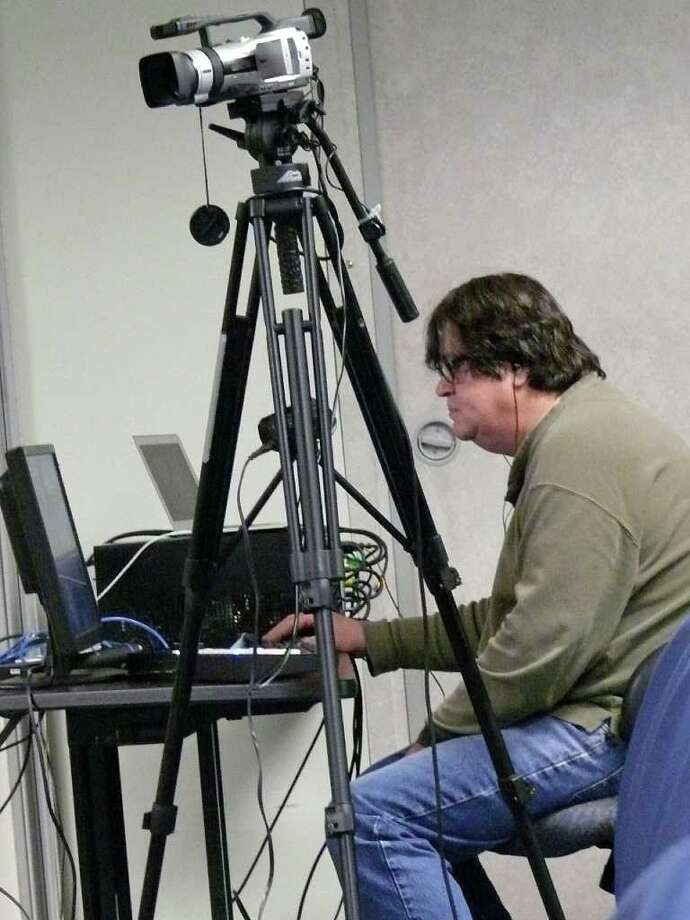 Gerry Speno, executive producer at Fair TV, mans the camera at a live broadcast of a budget hearing. Photo: Genevieve Reilly / Fairfield Citizen