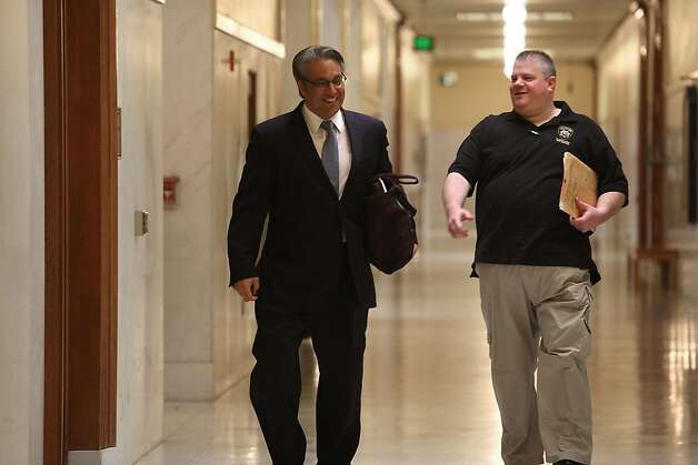 Sheriff Ross Mirkarimi (left) walking to his office at city hall in San Francisco, Calif., on Tuesday, March 20, 2012. Photo: Liz Hafalia, The Chronicle