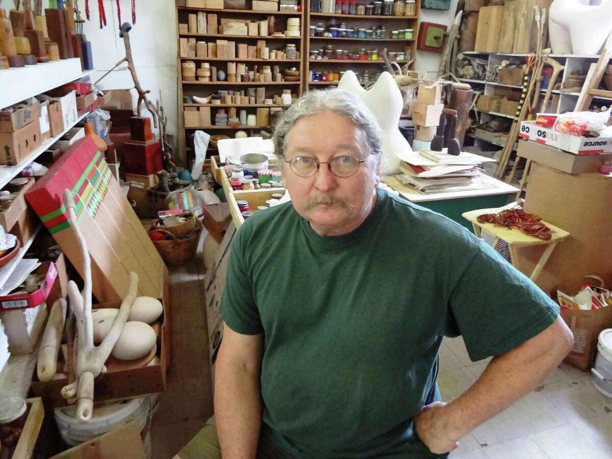 San Antonio artist Danville Chadbourne, in his Beacon Hill studio that was once a corner grocery store, makes art from wood and ceramics that is highly evocative of ancient, primal totemic forms.