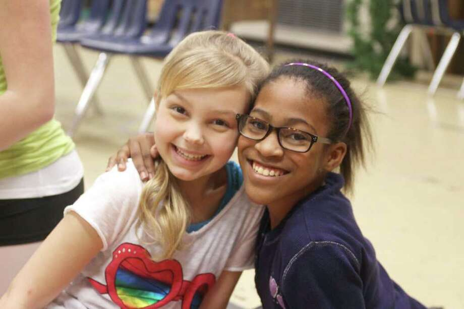 Savannah May and Raiya Goodman at the rehearsal for the upcoming TUTS production of Annie. Photo by Pin Lim. Photo: Pin Lim / Copyright Pin Lim.