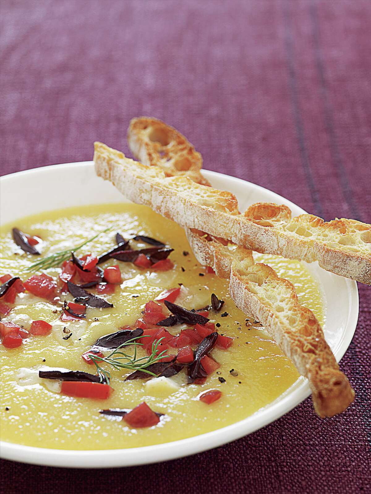 Golden Cauliflower Soup With Goat Cheese, Olives, and Tomato