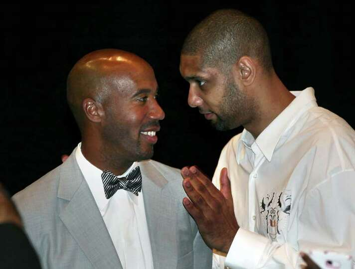 Former Spurs Bruce Bowen, left, and Spurs Tim Duncan share a moment at Bowen's Jersey Reitement Lunc