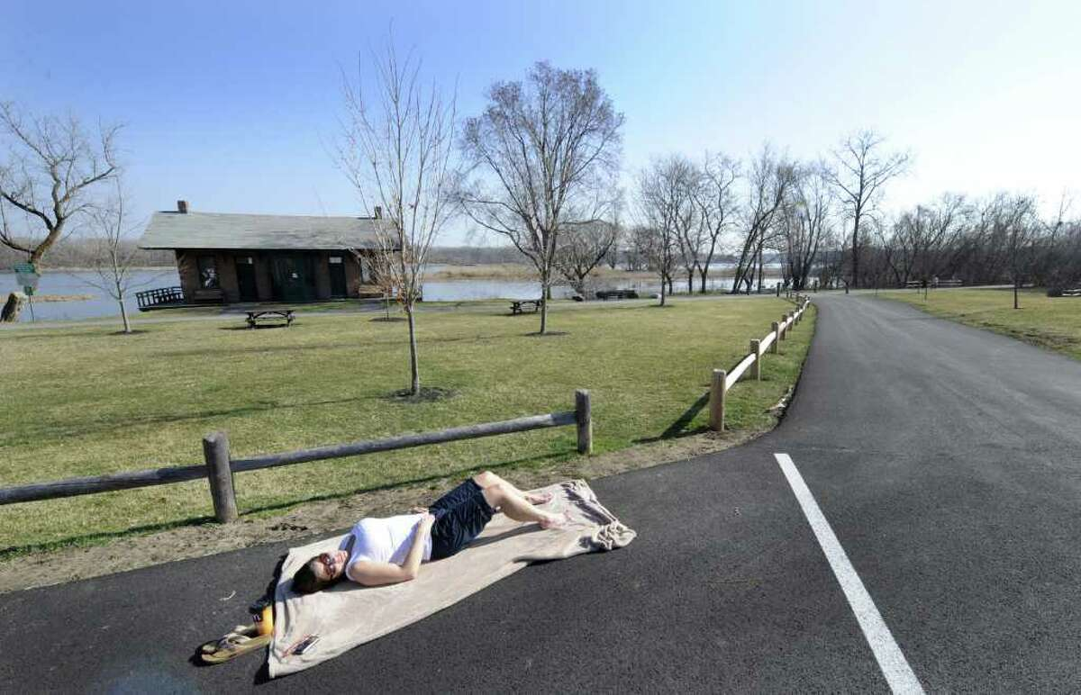 Sherry Burroughs of Whitehall enjoys the sun's warmth at Lions Park in Niskayuna, N.Y. March 20, 2012. (Skip Dickstein/Times Union)