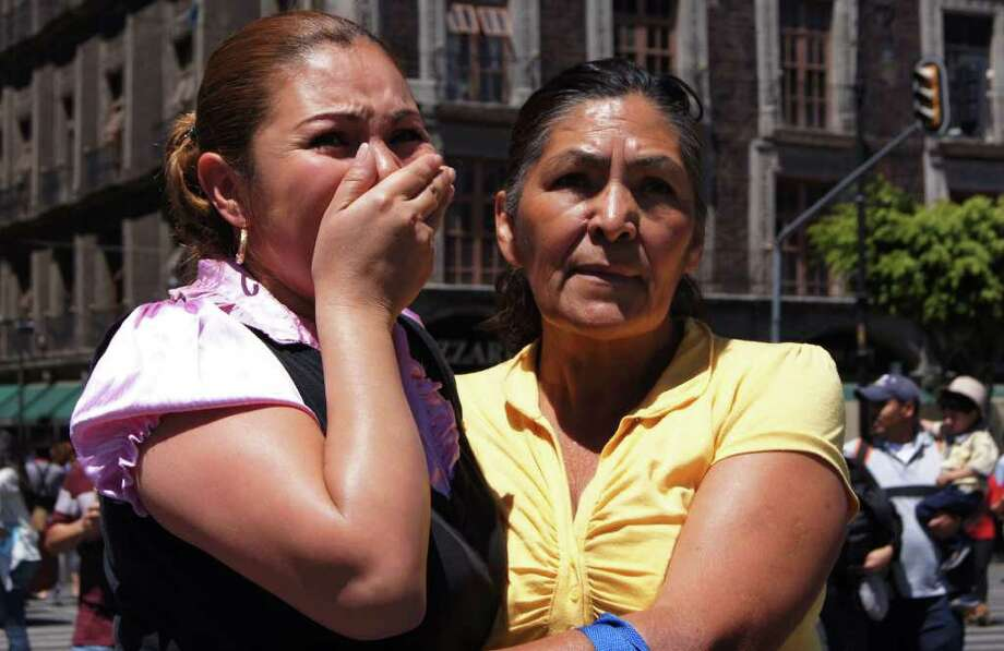 A woman reacts after a strong quake hit Mexico, at the El Zocalo square in Mexico City on March 20, 2012. A powerful 7.6-magnitude earthquake struck southwest Mexico, causing residents in the capital several hundred miles away to rush out onto the streets but no immediate reports of serious damage. The quake struck near the tourist resort of Acapulco, just after midday some 25 km northeast of the town of Ometepec, the US Geological Survey said. Earlier it had estimated the magnitude at 7.9, before downgrading it to 7.6. Photo: ANGEL GARCIA, AFP/Getty Images / AFP