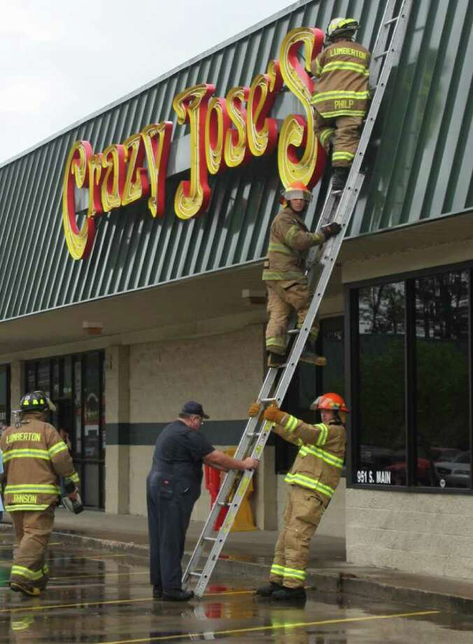 Firefighters from Lumberton Fire and EMS were dispatched to Crazy Jose s Mexican Restaurant on South Main in Lumberton Tuesday afternoon and found an electrical short had ignited bird s nests behind a neon sign. Photo: David Lisenby, HCN_Jose's