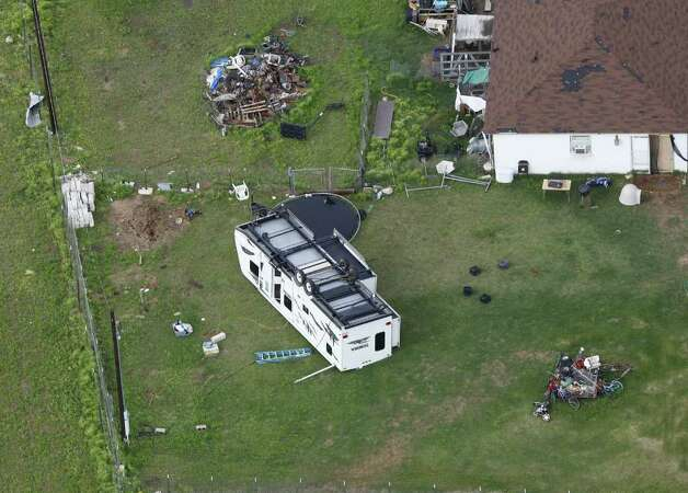 Damage from an overnight tornado in the Devine area is seen in this Tuesday March 20, 2012 aerial image. Photo: William Luther, William Luther/wluther@express-news.net / © 2012 WILLIAM LUTHER