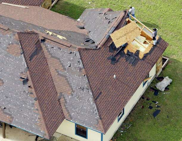 People begin Tuesday March 20, 2012 to repair roof damage from an overnight tornado in the Devine area as seen in this aerial image. Photo: William Luther, William Luther/wluther@express-news.net / © 2012 WILLIAM LUTHER
