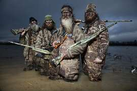 The Robertson duck hunters in A&EÕs real life series, Duck Dynasty.