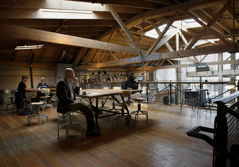 Large tables, exposed beams and skylights enliven the second floor at Sightglass Coffee. Photo: Brant Ward, The Chronicle