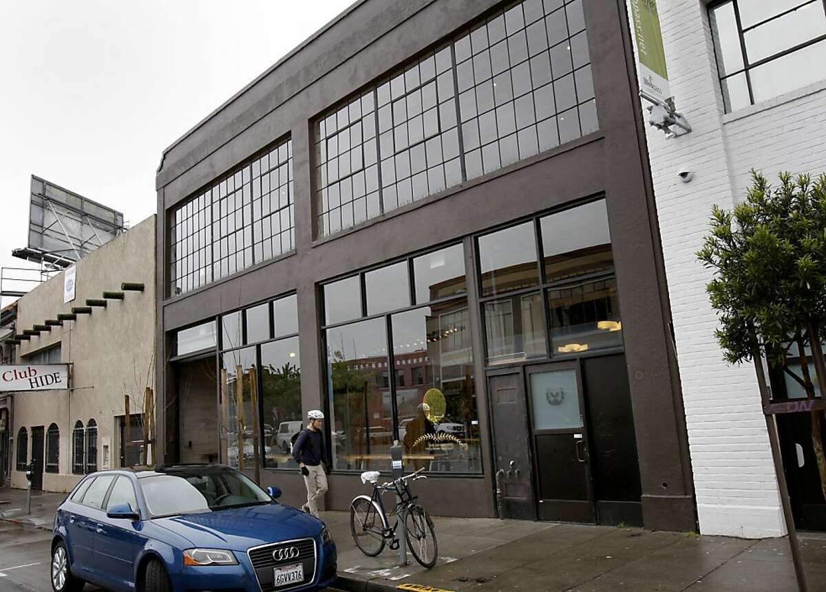 Sightglass Coffee (center) joins other non-warehouse businesses on 7th Street. Sightglass Coffee company took the interior of a nondescript warehouse on 7th Street in San Francisco, Calif. and reinvented it with interlocking levels and renovations.