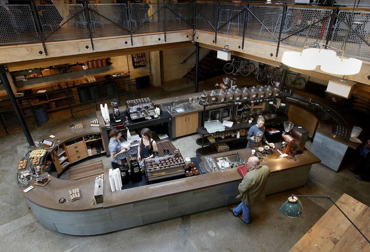The retail area features a large coffee bar on the first floor. Sightglass Coffee company took the interior of a nondescript warehouse on 7th Street in San Francisco, Calif. and reinvented it with interlocking levels and renovations.