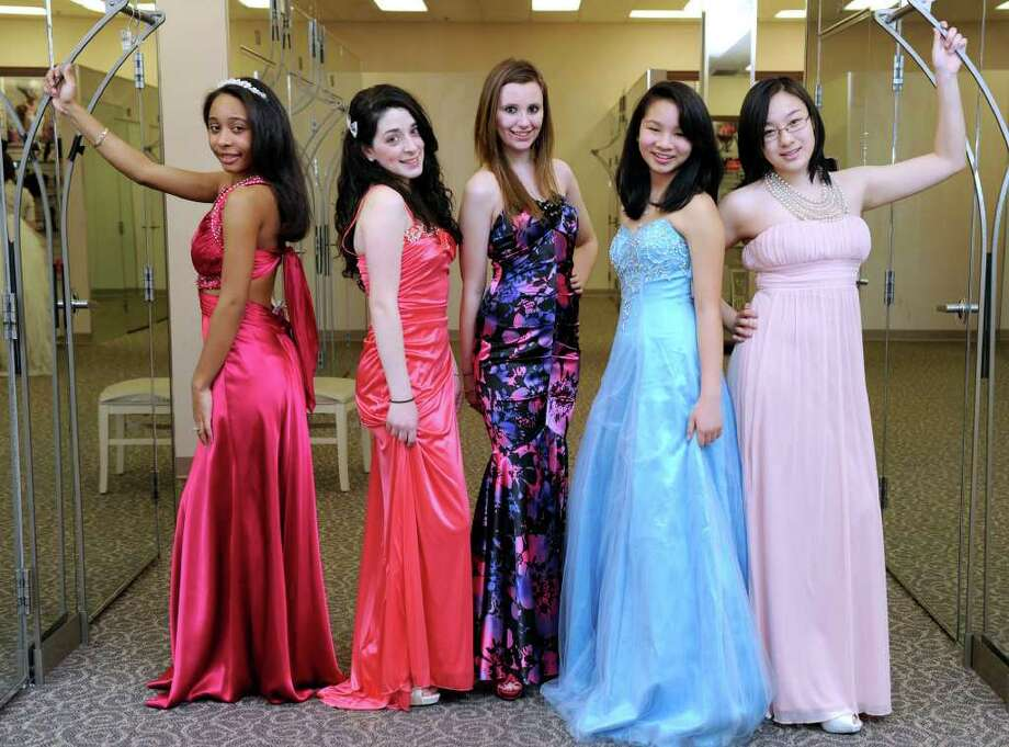 d6ebe80033 Trying on fashions at David s Bridal in Danbury are from left