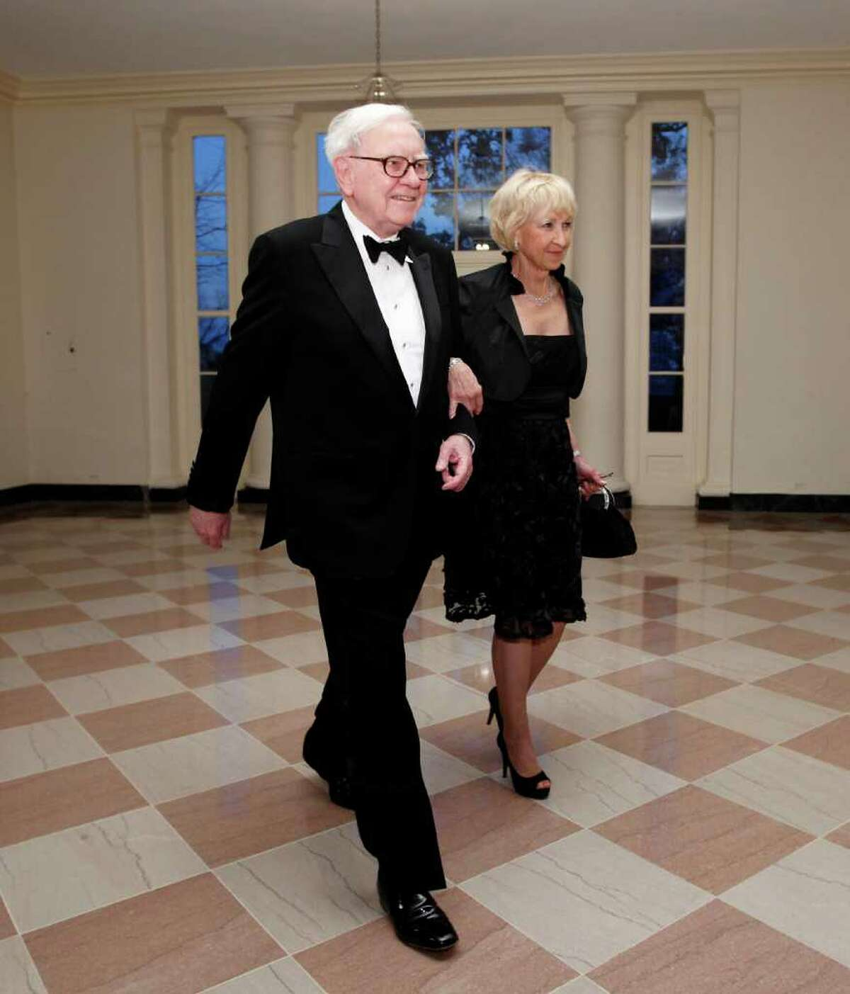 FILE - In this March 14, 2012 file photo, Warren Buffett and Astrid M. Buffett arrive at the Booksellers area of the White House in Washington for the State Dinner hosted by President Barack Obama and first lady Michelle Obama for British Prime Minister David Cameron and his wife Samantha. A bill designed to enact President Barack Obama's plan for a