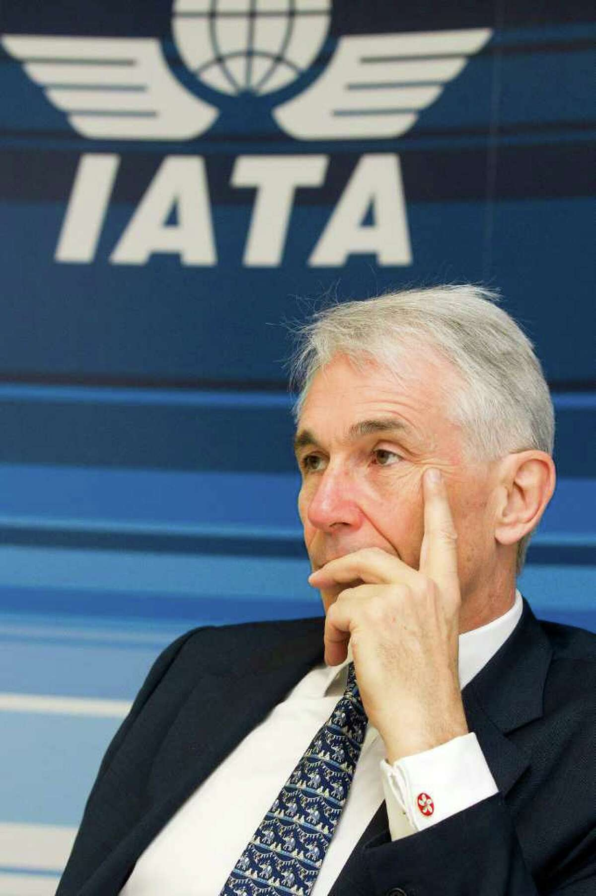 Tony Tyler, Director General and CEO of the International Air Transport Association, IATA, informs the media about the situation of the oil prices for the airlines and the updated financial forecast during a press conference in Geneva, Switzerland, Tuesday, March 20, 2012. (AP Photo/Keystone, Salvatore Di Nolfi)