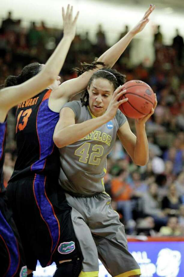 Baylor's Brittney Griner (42) makes a move in the lane against Florida's Azania Stewart (13) during the first half of a second-round NCAA women's tournament college basketball game, Tuesday, March 20, 2012, in Bowling Green, Ohio. (AP Photo/J.D. Pooley) Photo: J.D. Pooley, Associated Press / FR89303 AP