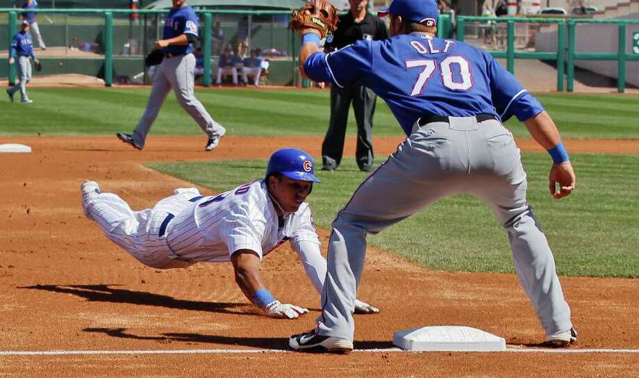 Texas Rangers third baseman Mike Olt waits for the ball during the first inning of a spring training baseball game earlier this year. The former Danbury Westerner, UConn star and Branford, CT resident made his Major League debut Thursday night. Photo: AP