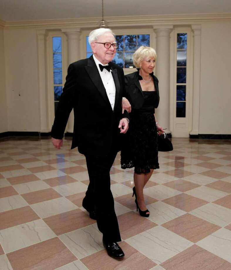"FILE - In this March 14, 2012 file photo, Warren Buffett and Astrid M. Buffett arrive at the Booksellers area of the White House in Washington for the State Dinner hosted by President Barack Obama and first lady Michelle Obama for British Prime Minister David Cameron and his wife Samantha. A bill designed to enact President Barack Obama's plan for a ""Buffett rule"" tax on the wealthy would rake in just $31 billion over the next 11 years, according to an estimate by Congress' official tax analysts obtained by The Associated Press. (AP Photo/Charles Dharapak, File) Photo: Charles Dharapak / AP"