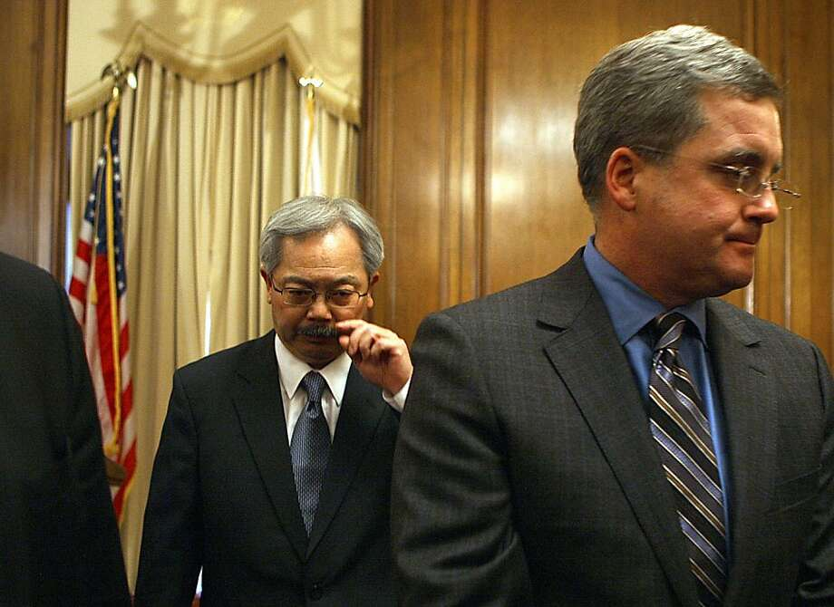 Mayor Ed Lee (left) is suspending Sheriff Ross Mirkarimi and appointing veteran law enforcement official Vicki Hennessy to take his place which he announced at his office at city hall in San Francisco, Calif., on Tuesday, March 20, 2012. At front right is City Attorney Dennis Herrera. Photo: Liz Hafalia, The Chronicle
