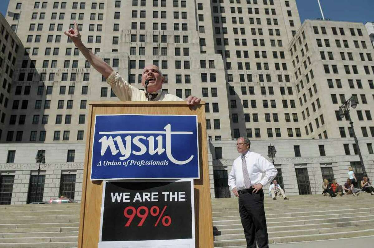 Richard Iannuzzi, president of New York State United Teachers, fires up his fellow union members during a rally by members of NYSUT and other unions supporting them outside the capitol on Tuesday, March 20, 2012 in Albany, NY. (Paul Buckowski / Times Union)