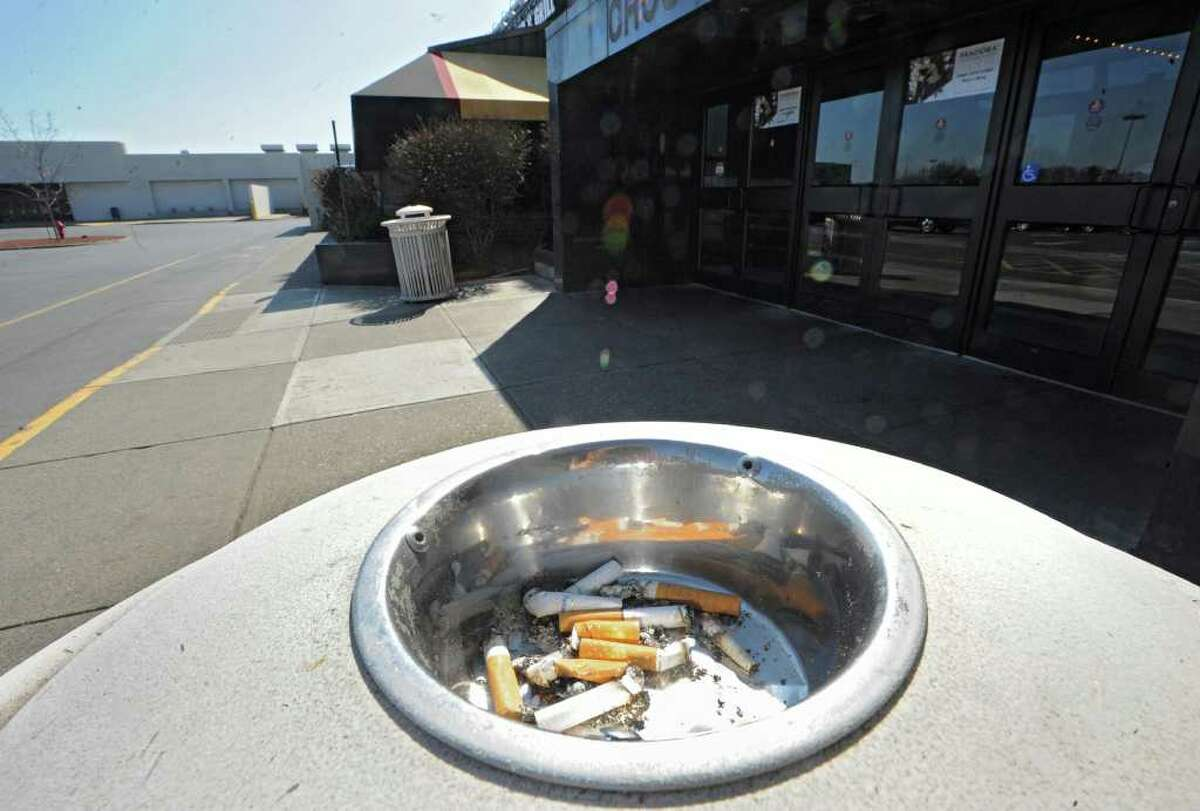 An ashtray holds cigarette butts outside an entrance to Crossgates Mall on March 20, 2012, in Guilderland, N.Y. Starting May 31, Crossgates is banning smoking anywhere on its property. (Lori Van Buren / Times Union)