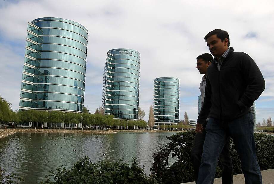 REDWOOD SHORES, CA - MARCH 20:  Pedestrians walks by Oracle headquarters on March 20, 2012 in Redwood Shores, California.  Oracle will report third quarter earnings today after the closing bell. (Photo by Justin Sullivan/Getty Images) Photo: Justin Sullivan, Getty Images