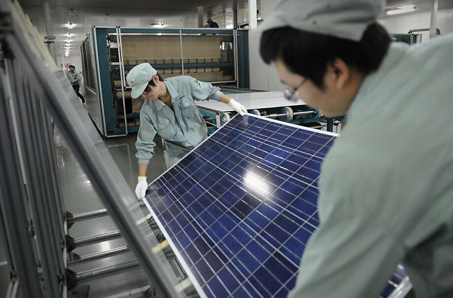 Chinese workers assemble solar panels for Suntech in Wuxi. Photo: Peter Parks, AFP/Getty Images