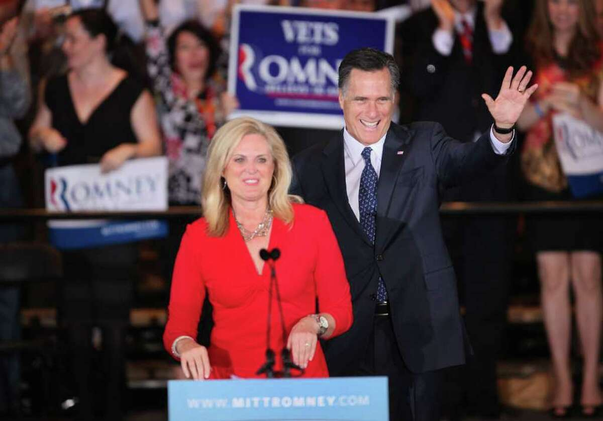 SCHAUMBURG, IL - MARCH 20: Republican Presidential candidate Mitt Romney and his wife Ann greet supporters at the at a victory party following the close of voting for the Illinois primary on March 20, 2012 in Schaumburg, Illinois. Exit polls showed Romney leading his closest rival, former Sen. Rick Santorum, and will keep his lead in the delegate count. (Photo by Scott Olson/Getty Images)