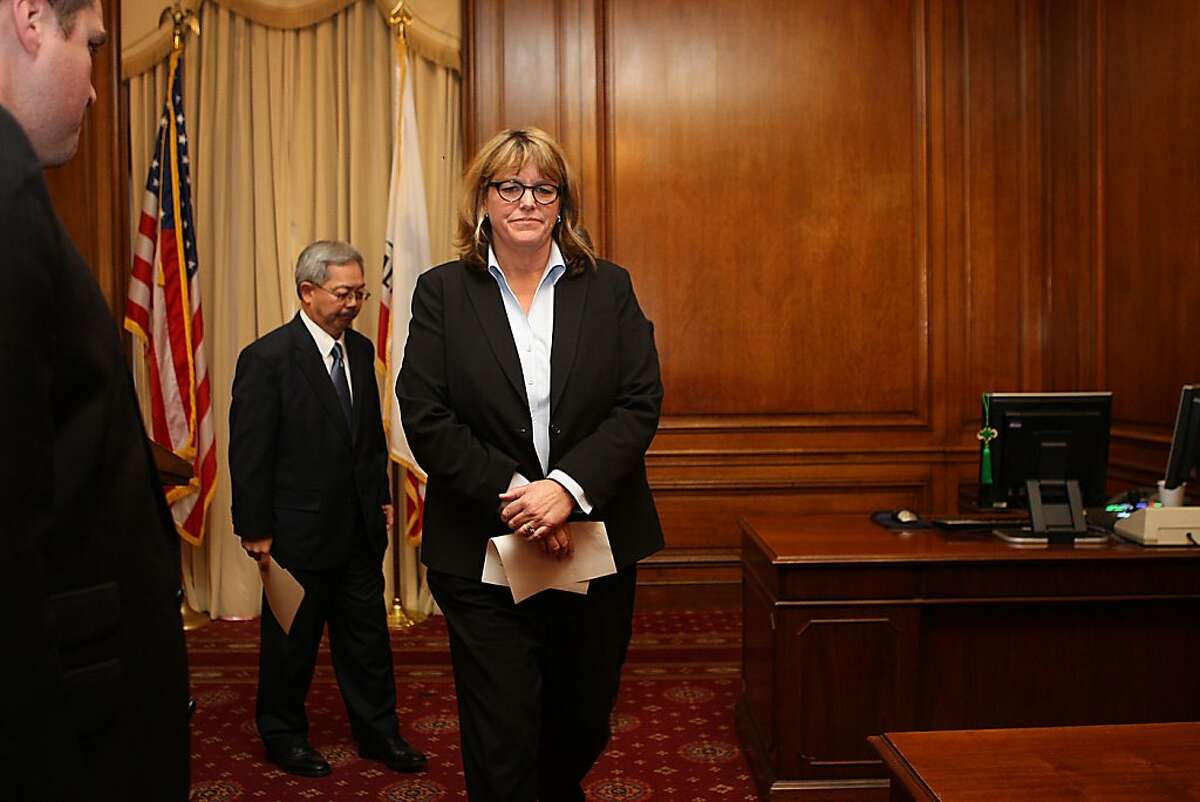 Mayor Ed Lee (back) is suspending Sheriff Ross Mirkarimi and appointing veteran law enforcement official Vicki Hennessy (front) to take his place which he announced at his office at city hall in San Francisco, Calif., on Tuesday, March 20, 2012.