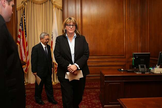 Mayor Ed Lee (back) is suspending Sheriff Ross Mirkarimi and appointing veteran law enforcement official Vicki Hennessy (front) to take his place which he announced at his office at city hall in San Francisco, Calif., on Tuesday, March 20, 2012. Photo: Liz Hafalia, The Chronicle