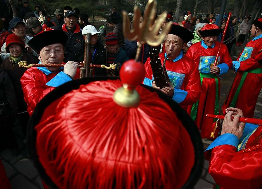 Musicians practice before a re-enactment of a Qing Dynasty Emperor's prayer ceremony at a park in Beijing, China, Tuesday, March 20, 2012. (AP Photo/Ng Han Guan) Photo: Ng Han Guan, Associated Press