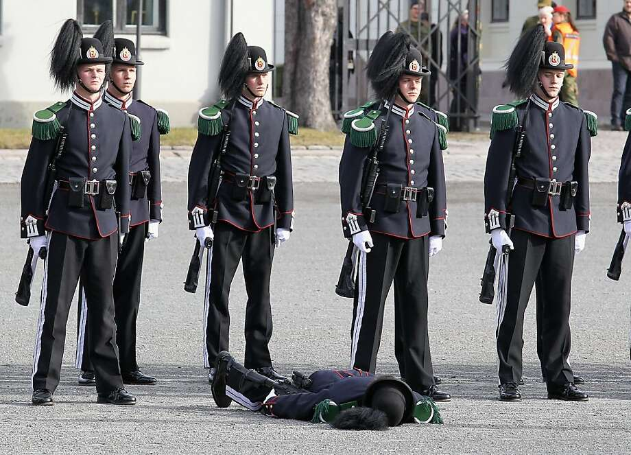 Standing at attention deficit disorder:A soldier passes out as Camilla, Duchess of Cornwall, and Prince Charles, Prince of Wales, arrive for a wreath-laying ceremony at the National Monument at Akershus Fortress in Oslo. Photo: Chris Jackson, Getty Images