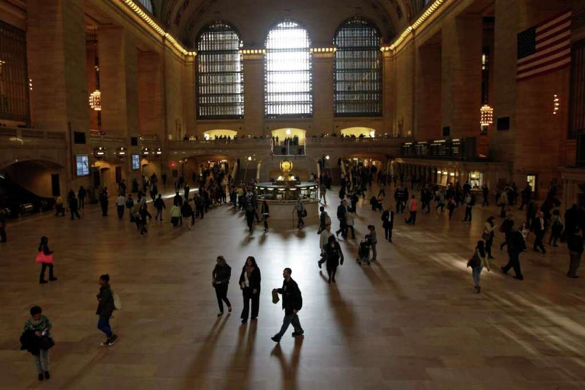 Morning commuters walk through Grand Central Terminal's main concourse, Tuesday, March 20, 2012 in New York. Metropolitan Transportation Authority officials unveiled Grand Central Terminal's new logo Tuesday, and previewed plans to mark the terminal's 100th anniversary in 2013. (AP Photo/Mary Altaffer)
