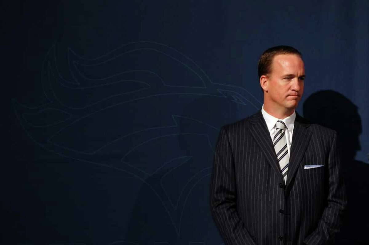 ENGLEWOOD, CO - MARCH 20: Quarterback Peyton Manning looks over at the podium during the news conference announcing his contract with the Denver Broncos in the team meeting room at the Paul D. Bowlen Memorial Broncos Centre on March 20, 2012 in Englewood, Colorado. Manning, entering his 15th NFL season, was released by the Indianapolis Colts on March 7, 2012, where he had played his whole career. It has been reported that Manning will sign a five-year, $96 million offer. (Photo by Justin Edmonds/Getty Images)