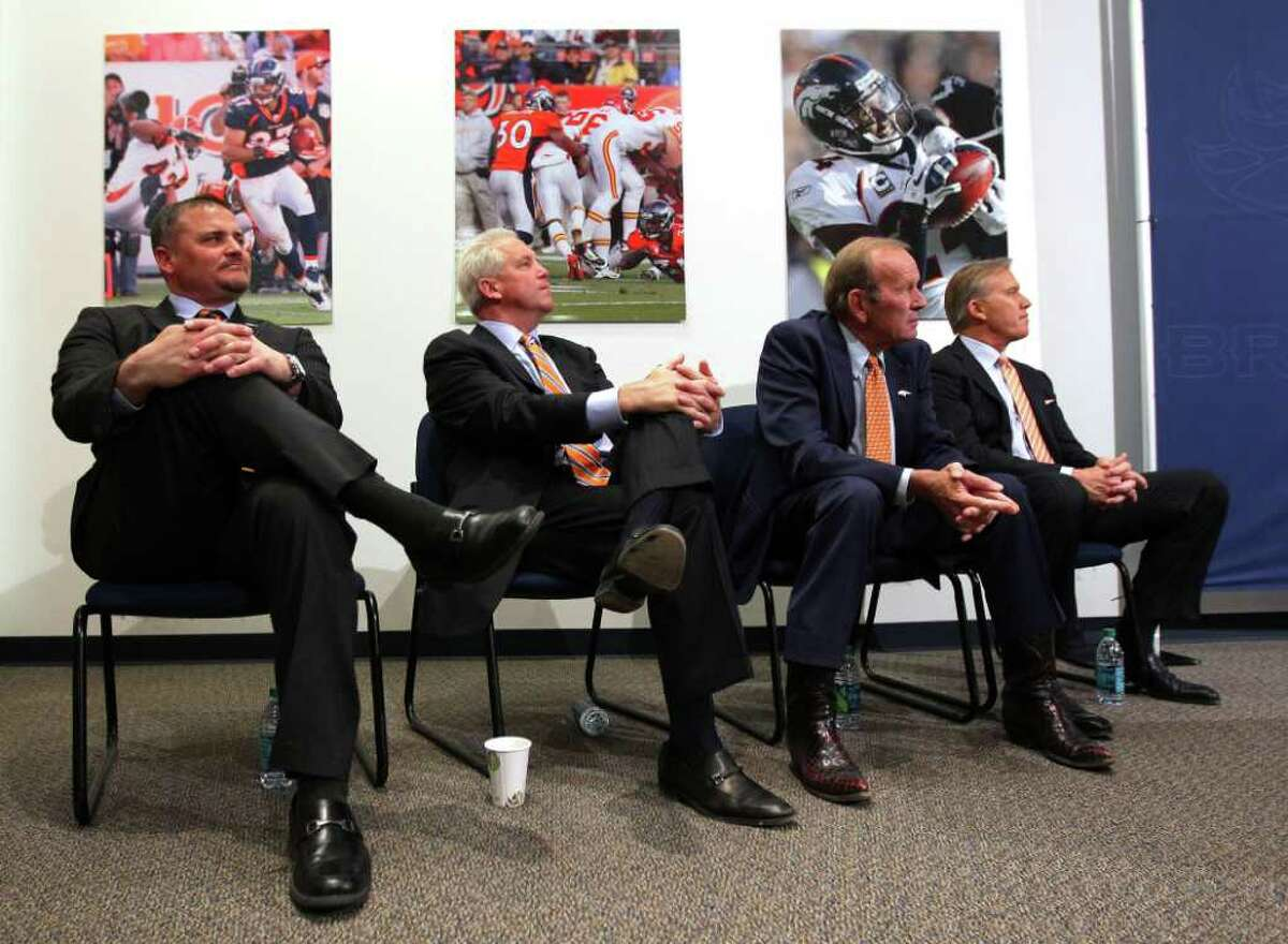ENGLEWOOD, CO - MARCH 20: (L-R) General manager Brian Xanders, head coach John Fox, majority owner, president, and CEO Pat Bowlen and executive vice president of football operations John Elway listen as quarterback Peyton Manning speaks during a news conference announcing Manning's contract with the Denver Broncos in the team meeting room at the Paul D. Bowlen Memorial Broncos Centre on March 20, 2012 in Englewood, Colorado. Manning, entering his 15th NFL season, was released by the Indianapolis Colts on March 7, 2012, where he had played his whole career. It has been reported that Manning will sign a five-year, $96 million offer. (Photo by Doug Pensinger/Getty Images)