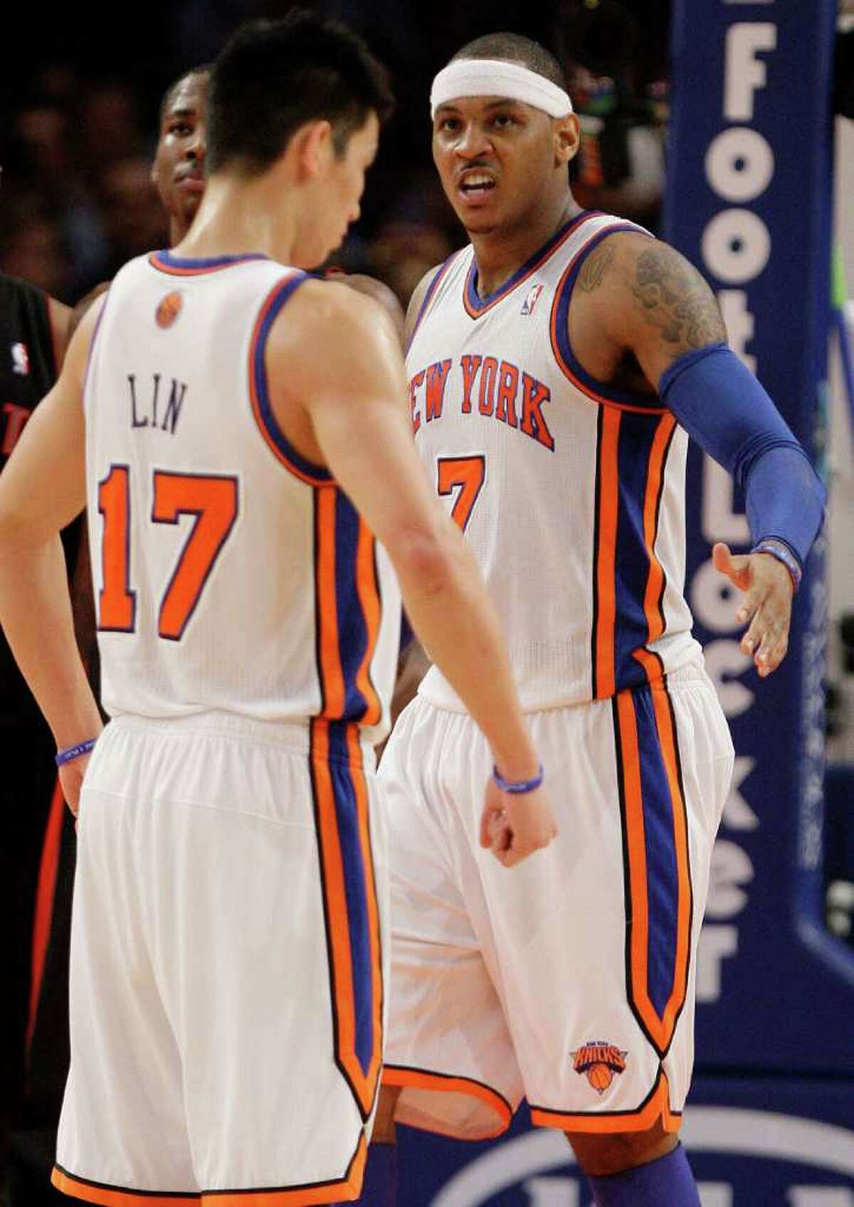 New York Knicks' Carmelo Anthony (7) reacts as teammate Jeremy Lin (17) looks on during the second half of an NBA basketball game against the Toronto Raptors, Tuesday, March 20, 2012, in New York. The Knicks won 106-87 (AP Photo/Frank Franklin II)