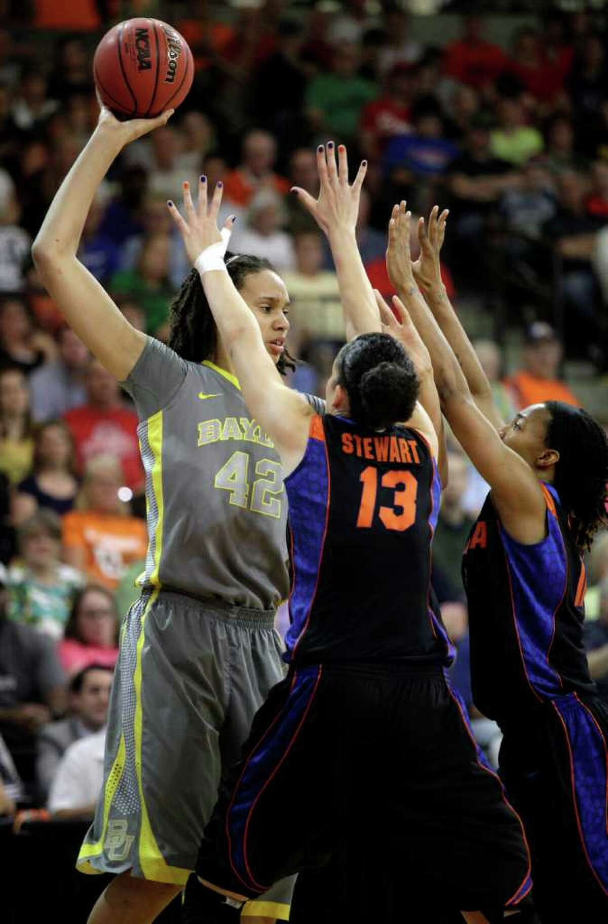 Baylor's Brittney Griner (42) is defended by Florida's Azania Stewart (13) and Deana Allen during the first half of a second-round NCAA college women's basketball tournament game, Tuesday, March 20, 2012, in Bowling Green, Ohio. (AP Photo/J.D. Pooley)
