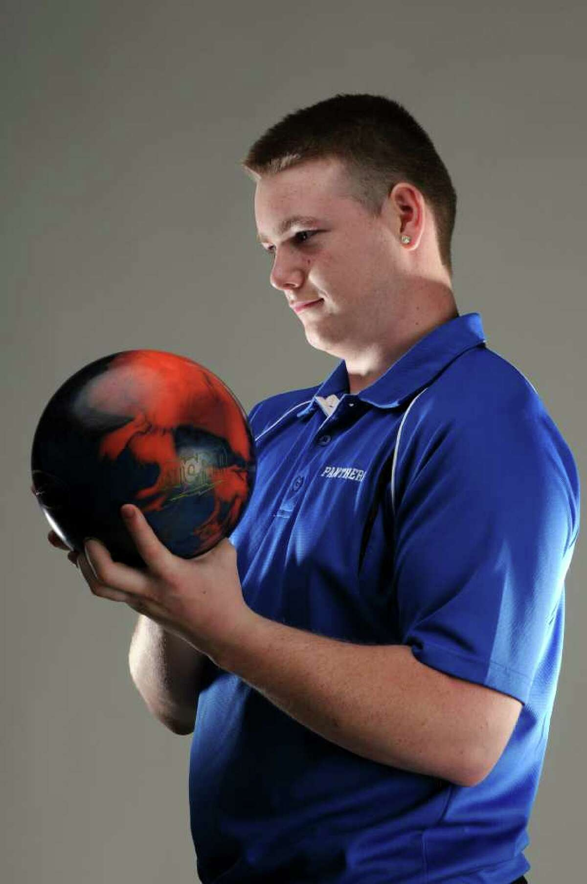 Hoosick Falls bowler Joe Wolfrum in the Times Union photography studio on Monday evening March 19, 2012 in Colonie, N.Y. (Philip Kamrass / Times Union )
